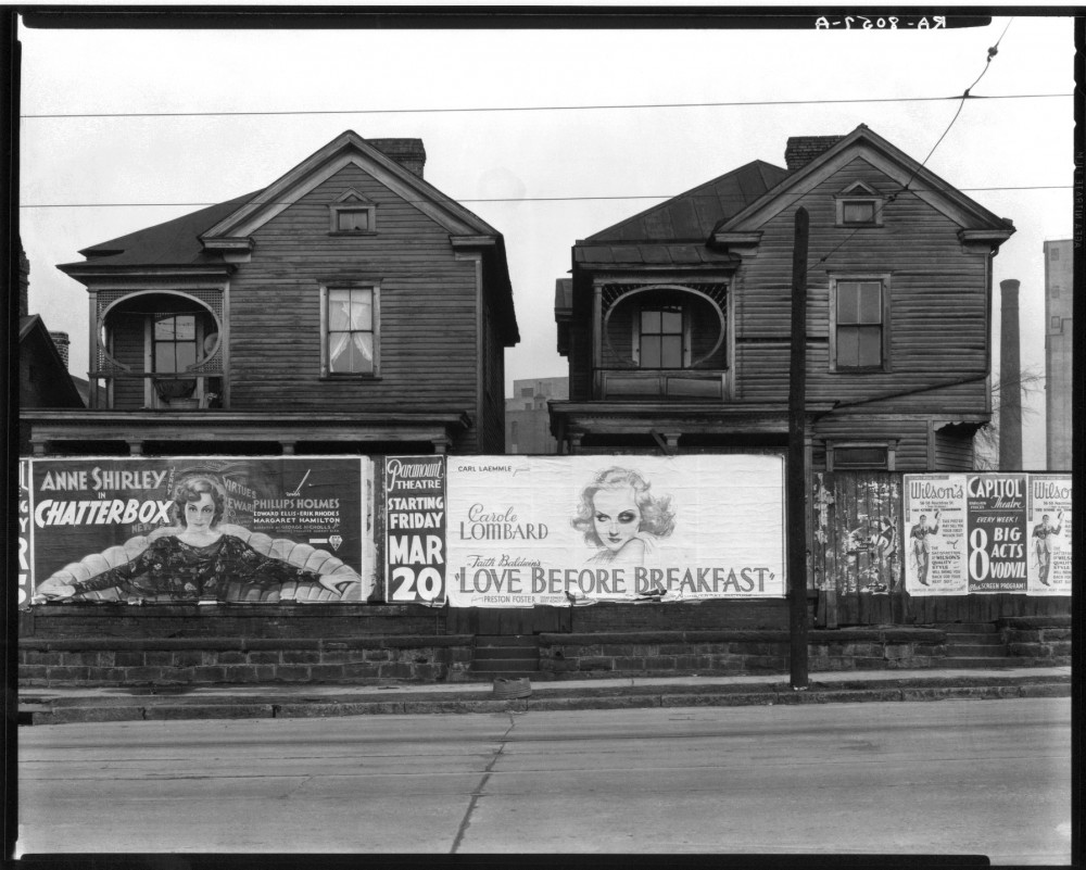 542a1aaac07a80c9ea00024d_constructing-worlds-photography-and-architecture-in-the-modern-age-_11-_walker_evans__frame_houses_and_a_billboard__atlanta__g-1000x801